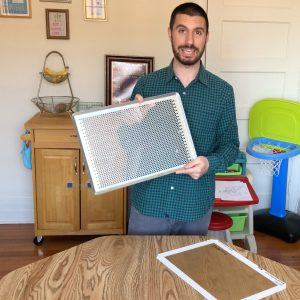 holding perforated baking sheet